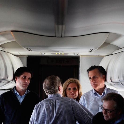 "IN FLIGHT - JANUARY 04:  Republican presidential candidate and former Massachusetts Governor Mitt Romney (2nd R) talks with (L-R) son Tagg Romney, campaign advisors Stuart Stevens, wife Ann Romney and advisor Eric Fehrnstrom on a chartered airplane after departing Des Moines, Iowa, January 4, 2012 while en route to Manchester, New Hampshire. Romney beat former U.S. Senator Rick Santorum by only eight votes in Tuesday's ""first in the nation"" Iowa Caucuses.  (Photo by Chip Somodevilla/Getty Images)"