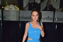 Lindsay Lohan emerged from Mr Chow, wearing a lovely blue summer evening dress.