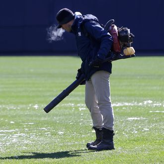A member of the grounds crew blows ice chunks off the field before a baseball game between the Houston Astros and the New York Yankees at Yankee Stadium, Tuesday, April 5, 2016 in New York. The opener between the Astros and Yankees was postponed Monday because of rain and cold. (AP Photo/Seth Wenig)