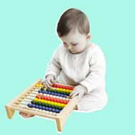 Studio portrait of baby girl playing with abacus