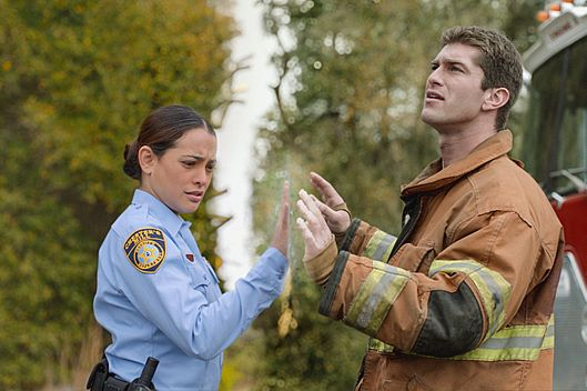 UNDER THE DOME: Deputy Linda (Natalie Martinez, left) and her fianc?ƒ??, Rusty (Josh Carter), find themselves separated by a massive transparent dome that???€?™s suddenly fallen on the town of Chester???€?™s Mill, on UDER THE DOME premiering Monday, June 24 (10:00-11:00 PM, ET/PT) on CBS.  UNDER THE DOME is based on Stephen King???€?™s bestselling novel.. Photo: Best Possible Screen Grab/?'??2013 CBS Broadcasting Inc. All Rights Reserved.