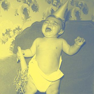Five-month-old Louis Acerra, of Maspeth, LI, rings in the New Year with a lusty mowl. It isn't that the outlook for 1947 is so bad; it's just he wants to get his quota of crying done before 1946 bows out.