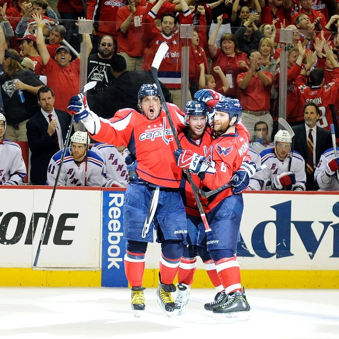 WASHINGTON, DC - MAY 05: Mike Green #52 of the Washington Capitals celebrates with Alex Ovechkin #8 and Dennis Wideman #6 after scoring the game winning goal in the third period against the New York Rangers in Game Four of the Eastern Conference Semifinals during the 2012 NHL Stanley Cup Playoffs at the Verizon Center on May 5, 2012 in Washington City. Washington won the game 3-2. (Photo by Greg Fiume/Getty Images)