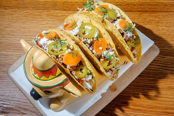 "<b>Where to Get It:</b> <a href=""http://nymag.com/listings/restaurant/the-dutch/"">The Dutch</a>  The restaurant tells us the catalyst for this dish was the silly taco caddy they found. So, to get the actual dish in the restaurant, they started making tacos. In this case, it's lamb meat that's been spiced, smoked and cooked in beer, topped with radish, cilantro, cabbage, lime, queso fresco, pickled jalapeño, and carrot-tomatillo-garlic-chipotle salsa."
