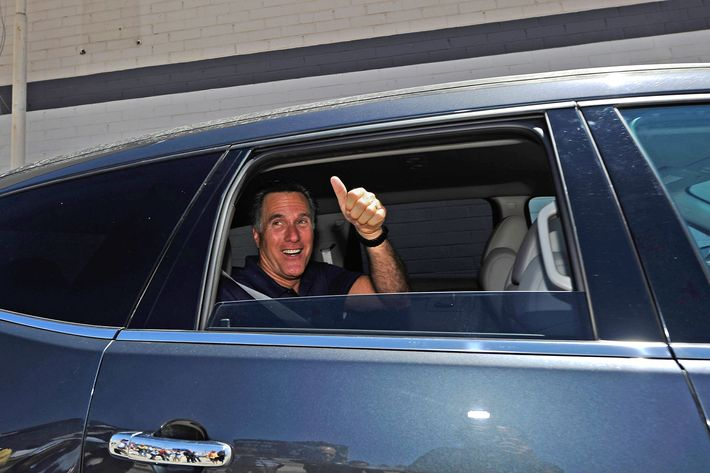 Republican presidential candidate and former Massachusetts Gov. Mitt Romney gives a thumbs up after speaking to supporters in front of vacant stores of the Valley Plaza shopping center to a campaign stop on July 20, 2011 in Los Angeles, California.