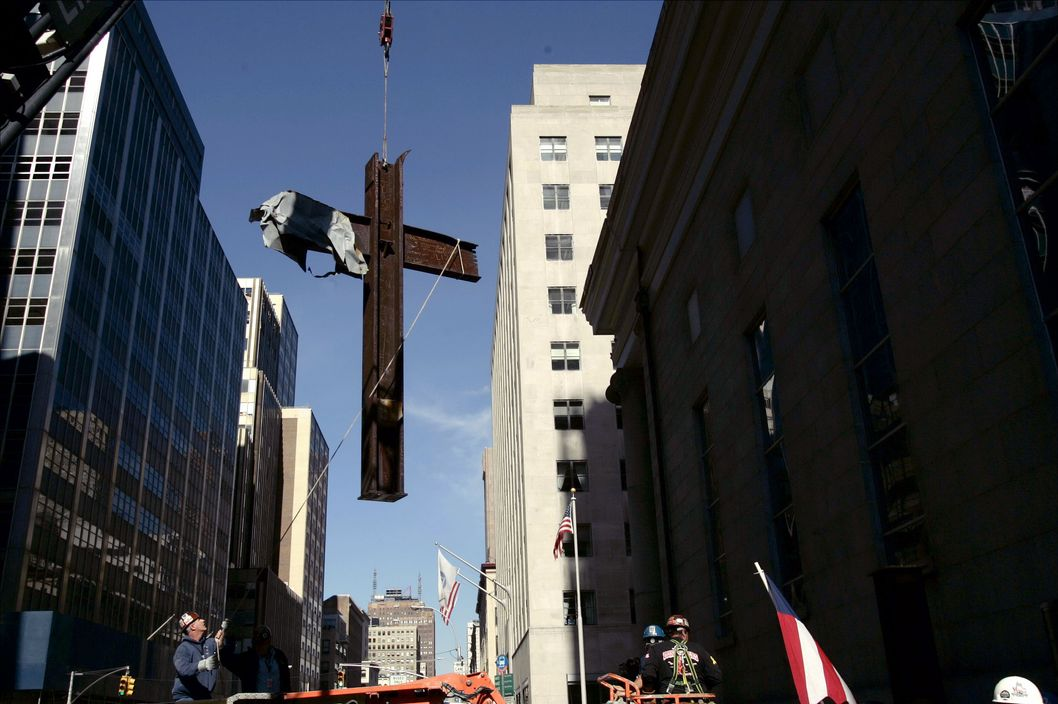 UNITED STATES - OCTOBER 05:  The cross made from steel beams found standing in the rubble of the World Trade Center is moved from Ground Zero to St. Peter's Church, where it will be installed for the next three years.  (Photo by Michael Appleton/NY Daily News Archive via Getty Images)