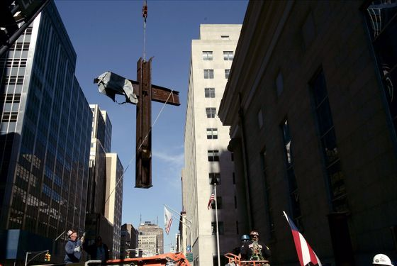 The cross is moved in 2006 from ground zero to nearby St. Peter's Church, where it had rested until this month.