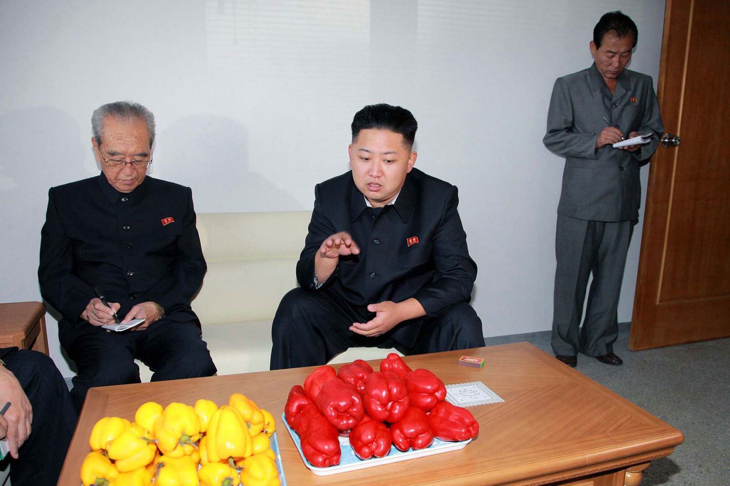 This undated picture released from North Korea's official Korean Central News Agency (KCNA) via the Korean News Service on September 22, 2012 shows North Korean leader Kim Jong Un (C) during a visit to the Pyongyang Vegetable Science Institute in Pyongyang.