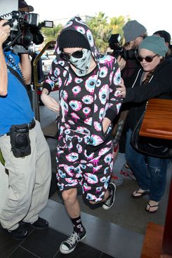 Ke$ha is seen arriving at LAX airport on November 26, 2013 in Los Angeles, California.