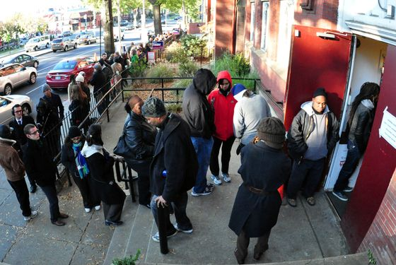 A long line of voters is seen outside Mt.Bethel Baptist Church in Washington, DC on November 6, 2012 as Americans headed to the polls Tuesday after a burst of last-minute campaigning by President Barack Obama and Mitt Romney in a nail-biting contest unlikely to heal a deeply polarized nation.