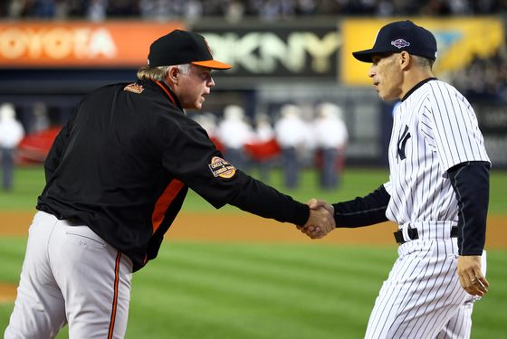 Buck Showalter of the Baltimore Orioles greets Joe Girardi of the New York Yankees prior to Game Three of the American League Division Series at Yankee Stadium on October 10, 2012 in the Bronx borough of New York City.