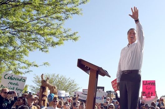 Massachusetts Gov. Mitt Romney waves during a campaign rally at Alice Pleasant Park on May 29, 2012 in Craig, Colorado. Mitt Romney will campaign in Colorado and Las Vegas, Nevada.