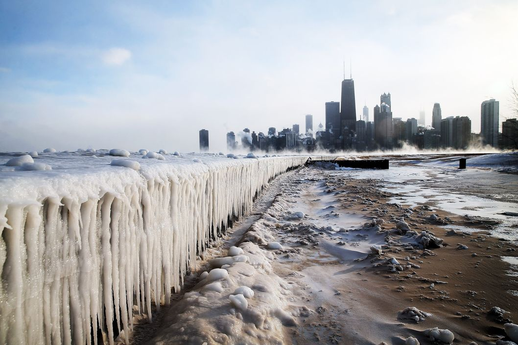 CHICAGO, IL - JANUARY 06:  Ice builds up along Lake Michigan at North Avenue Beach as temperatures dipped well below zero on January 6, 2014 in Chicago, Illinois. Chicago hit a record low of  -16 degree Fahrenheit this morning as a polar air mass brought the coldest temperatures in about two decades into the city.  (Photo by Scott Olson/Getty Images)