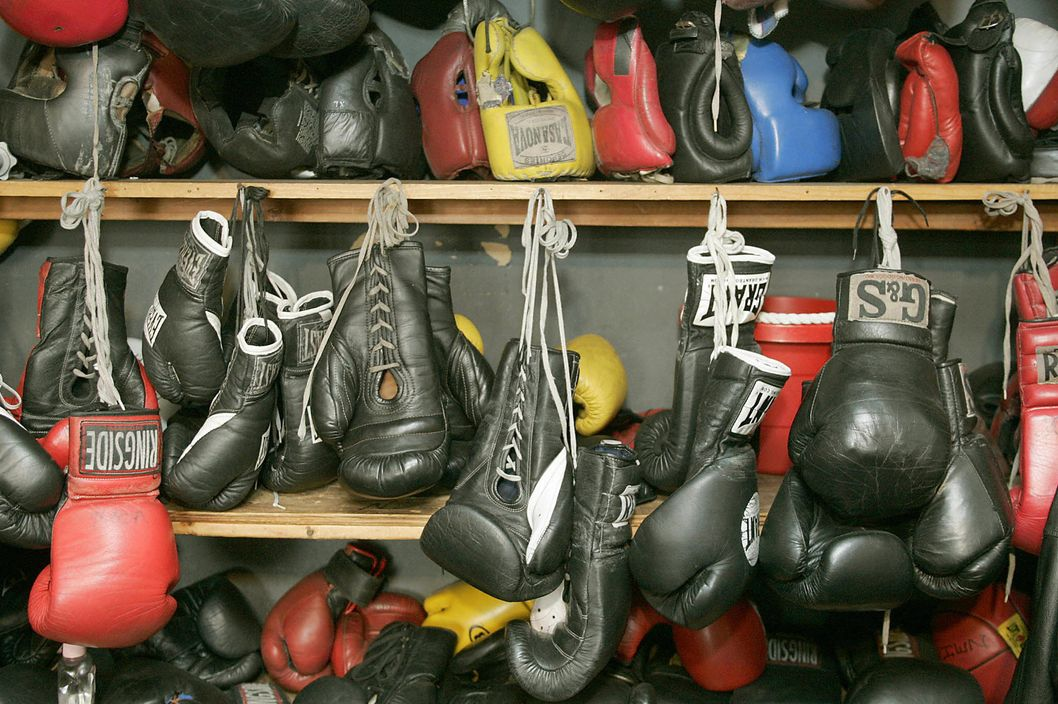 "BROOKLYN, UNITED STATES:  Panamanian who trained Hilary Swank as boxer found a true star pupil:   Boxing golves and headgear from past champions line the shleves of Legendary boxing trainer Hector ""Panama"" Roca  at Gleason's Gym in Brooklyn, New York 25 January 2005. Roca, who recently trained Hilary Swank for her role in the movie ""Million Dollar Baby"" ,has trained 13 world champions.   AFP PHOTO  / Timothy A. CLARY  (Photo credit should read TIMOTHY A. CLARY/AFP/Getty Images)"
