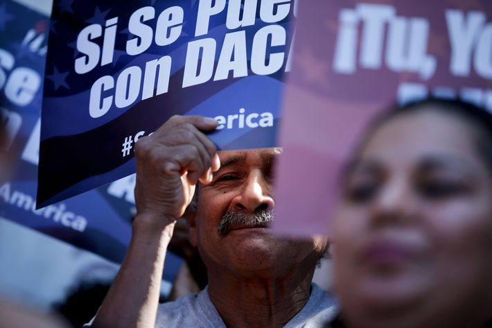 A man stands among signs during a rally in support of President Barack Obama's plan to protect more than 4 million people living illegally in the U.S. from deportation Tuesday, Feb. 17, 2015, in San Diego. Immigrants expressed disappointment Tuesday after a federal judge put a hold on the president's plan, but many said they haven't lost hope. (AP Photo/Gregory Bull)