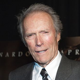 Director Clint Eastwood speaks with reporters as he arrives for the premiere of his latest movie