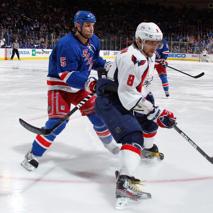 Dan Girardi #5 of the New York Rangers defends against Alex Ovechkin #8 of the Washington Capitals in Game One of the Eastern Conference Semifinals during the 2012 NHL Stanley Cup Playoffs at Madison Square Garden on April 28, 2012 in New York City.