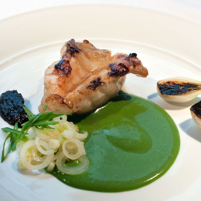 Grilled monkfish, green and black garlic, and lobster sauce.
