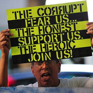Protesters shout slogans while holding banners after marching to the courthouse where the trial for Michael Jackson's doctor continues on October 3, 2011 in Los Angeles. They say they are inspired by revolutions in the Middle East, but protests over economic grievances in Spain and elsewhere in Europe are a closer comparison as anti-corporate demonstrations spread across the United States. As the Occupy Wall Street protest entered its third week Monday, it is being taken more seriously with similar sit-in demonstrations popping up from Boston to Chicago and Los Angeles and this week the New York protest expects to swell with support from trade unions. AFP PHOTO/Frederic J. BROWN (Photo credit should read FREDERIC J. BROWN/AFP/Getty Images)