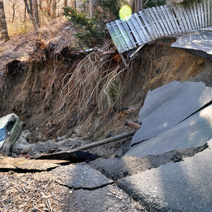 A vehicle sitting at the bottom of a large sinkhole is shown in this handout photo provided by the south Amboy Police Department in Amnboy, New Jersey March 24, 2015. The large sinkhole, believed to have been caused by an underground water main break, forced the evacuations of four New Jersey homes about 20 miles south of Newark, after suddenly forming early on Tuesday, crumbling part of a roadway and swallowing a car, police said. REUTERS/Amboy Police Dept/Handout via Reuters ATTENTION EDITORS - FOR EDITORIAL USE ONLY. NOT FOR SALE FOR MARKETING OR ADVERTISING CAMPAIGNS. THIS PICTURE WAS PROVIDED BY A THIRD PARTY. REUTERS IS UNABLE TO INDEPENDENTLY VERIFY THE AUTHENTICITY, CONTENT, LOCATION OR DATE OF THIS IMAGE. THIS PICTURE IS DISTRIBUTED EXACTLY AS RECEIVED BY REUTERS, AS A SERVICE TO CLIENTS - RTR4UOGL