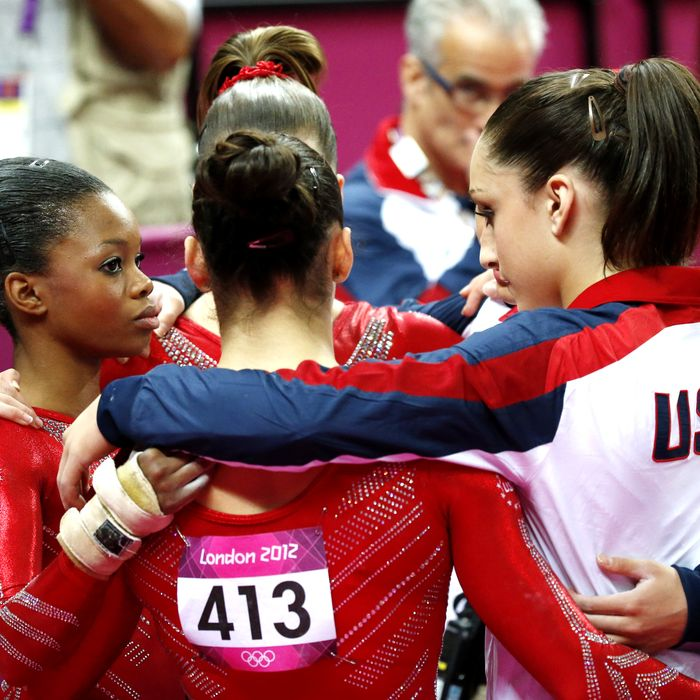 US gymnast Alexandra Raisman (C) and teammates react during the women's team final of the artistic gymnastics event of the London Olympic Games on July 31, 2012 at the 02 North Greenwich Arena in London.
