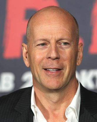 Bruce Willis, bald and proud.