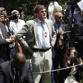 WASHINGTON, DC - JUNE 15: Neil Munro (C) of The Daily Caller listens as U.S. President Barack Obama's remarks about deportation of illegal immigrants June 15, 2012 in Washington, DC. Obama said the administration will stop deporting undocumented immigrants who had come to the U.S. when they were at a young age. Munro interrupted the President's remarks twice while he was trying to ask a question. (Photo by Alex Wong/Getty Images)