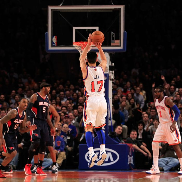 Jeremy Lin #17 of the New York Knicks shoots a three pointer against the Atlanta Hawks at Madison Square Garden on February 22, 2012 in New York City.