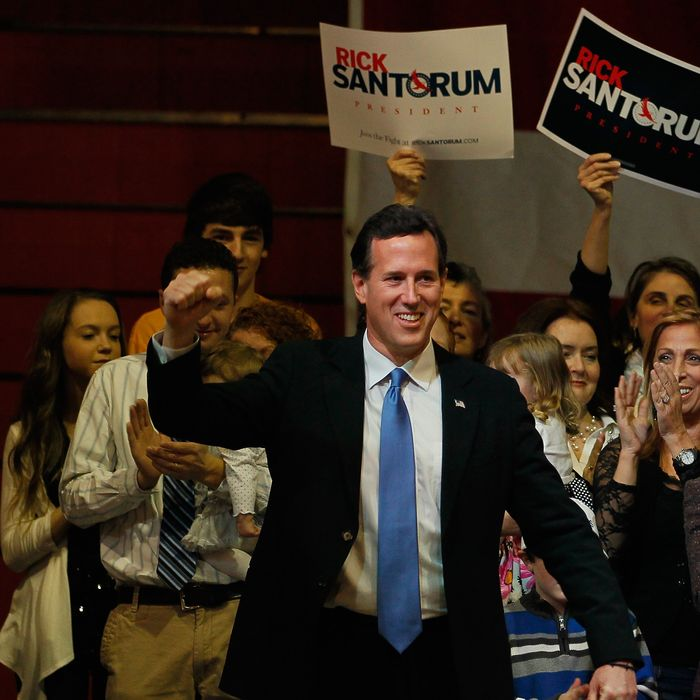STEUBENVILLE, OH - MARCH 06: Republican presidential candidate, former U.S. Sen. Rick Santorum arrives on stage during a primary night party at the Steubenville High School Gymnasium on March 6, 2012 in Steubenville, Ohio. The Republican Party continues the process of deciding if Republican presidential candidate, former Massachusetts Gov. Mitt Romney, Republican presidential candidate, U.S. Rep. Ron Paul (R-TX) or Republican presidential candidate, former Speaker of the House Newt Gingrich will be their general election candidate against President Barack Obama in the fall. (Photo by Joe Raedle/Getty Images)