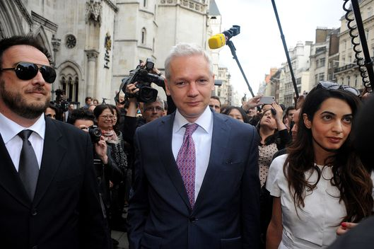 Wikileaks Founder Julian Assange, C, Leaves Britain's Royal Courts Of Justice with lawyer Amal Alamuddin After His Extradition Appeal Was Heard In Central London, Wednesday, July 13, 2011. Assange Is Fighting Extradition To Sweden On The Grounds That The Allegations Of Sexual Misconduct Laid Against Him There Don'T Amount To A Crime. Assange'S Repeated Disclosures Of Classified U.S. Documents Have Infuriated The Pentagon And Energized Critics Of American Foreign Policy, But Allegations That The 40-Year-Old Australian Molested Two Women During A Trip To Scandinavia Last Year Have Tarnished His Reputation And Cast A Shadow Over His Future. (Photo by John Phillips/UK Press via Getty Images)