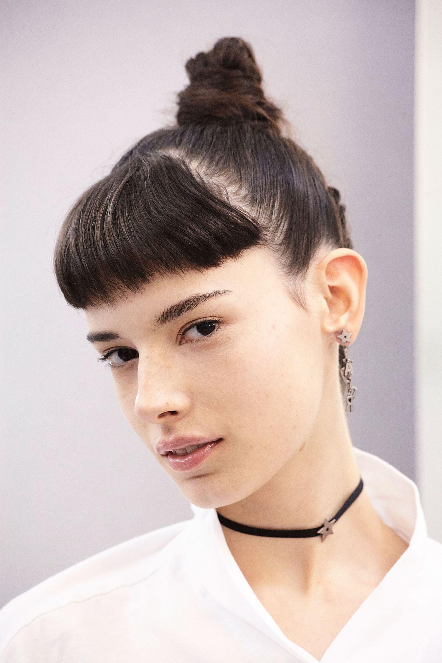 dior's spring 2017 show had girl-power makeup, topknots