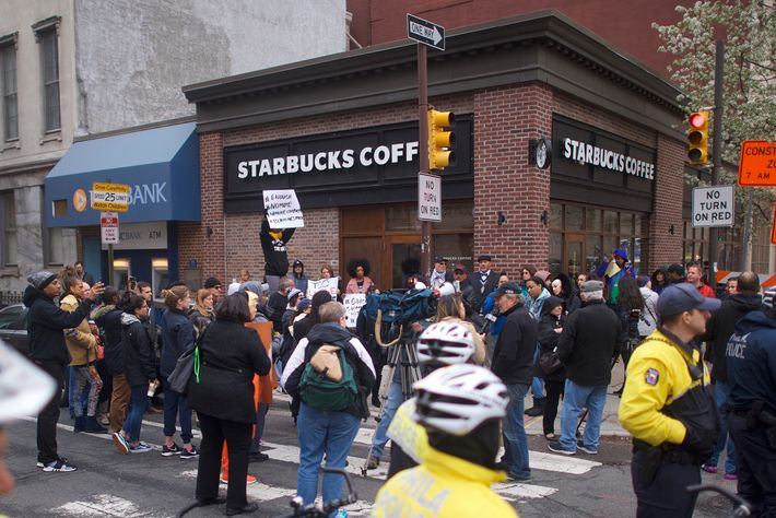 Protestors demonstrate outside a Center City Starbucks on April 15, 2018 in Philadelphia, Pennsylvania. Philadelphia Police arrested two black men in the same Center City Starbucks, which prompted an apology from the company's CEO.