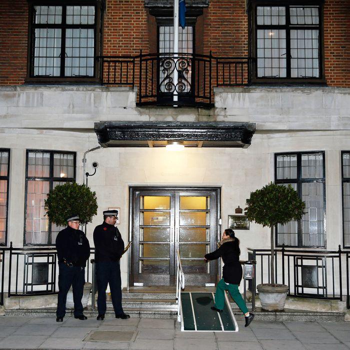 A nurse enters King Edward VII Hospital earlier today.