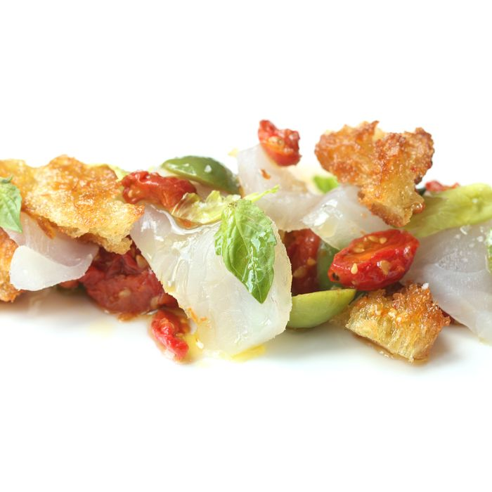 At Costata, fluke crudo comes with tomato confit, olives, and basil.