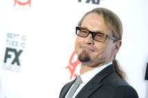 """HOLLYWOOD, CA - SEPTEMBER 07:  Writer/producer Kurt Sutter attends the season 6 premiere of FX's """"Sons Of Anarchy"""" at Dolby Theatre on September 7, 2013 in Hollywood, California.  (Photo by Kevin Winter/Getty Images)"""