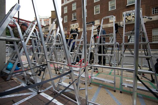 Ladders positioned to secure photographers positions stand outside The Lindo Wing of Saint Mary's Hospital in Paddington, west London on July 2, 2013, in preparation for the birth of a child at the hospital to Britain's Prince William, the Duke of Cambridge and Catherine, the Duchess of Cambridge. Prince William's wife Catherine is not officially due to give birth for two weeks but the world's media began gathering outside the London hospital where she will have the baby, determined not to miss the photograph of the year.