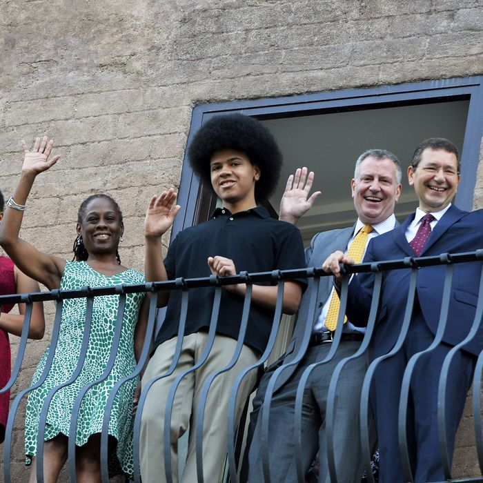 The mayor of Rome Ignazio Marino (R) poses with New York city mayor Bill de Blasio, his wife Chirlane McCray (2ndL) and their children Dante and Chiara at the balcony of Rome's city hall before their meeting on July 20, 2014. AFP PHOTO / ANDREAS SOLARO (Photo credit should read ANDREAS SOLARO/AFP/Getty Images)
