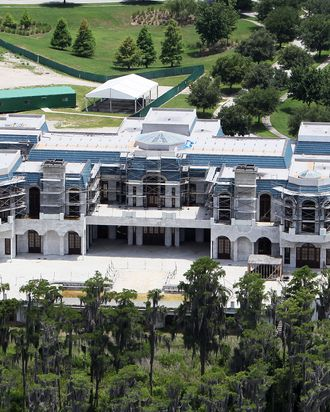 Aerial pictures of the biggest home in America - being built over 10 acres in Windermere, Florida, and modeled after France's historic Palace of Versailles - which is the centrepiece of an award-winning documentary opening this week and now a bitter dispute. The documentary, 'Queen of Versailles', is about time share mogul David Siegel, his former beauty queen wife Jackie, and the collapse of their dream home project when the recession hit. As they struggled to complete the gigantic project, they put the unfinished 13-bedroom, 23-bathroom mansion on sale for $75m, then $65m. The movie received rave reviews - as well as a prize at the Sundance Film Festival - as it showed an extravagant take on the implosion of the American Dream, according to reviews. Now, as the movie is about to be released, Mr Siegel has fired off a letter asking for the ending to be changed since he claims his company is healthy and he will now have no problems completing the construction. He is also suing the film makers over what he claims are defamatory statements about his economic situation, according to reports. Photos taken on 4/06/2010.<P>Pictured: house<P><B>Ref: SPL418464 180712 </B><br>Picture by: SDFL / Splash News</P><P><B>Splash News and Pictures</B><br>Los Angeles: 310-821-2666<br>New York: 212-619-2666<br>London: 870-934-2666<br>photodesk@splashnews.com<br></P>