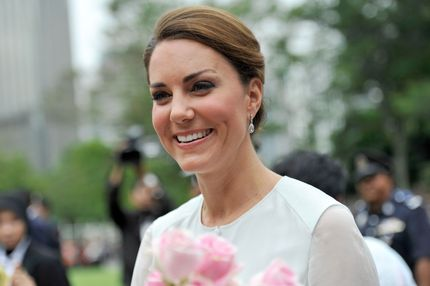 Catherine, the Duchess of Cambridge, smiles as she walks in the garden of KLCC during the Cultural Fair event in Kuala Lumpur. Britain's Prince William and his wife Catherine are visiting Malaysian capital Kuala Lumpur as part of a nine-day Southeast Asian and Pacific tour marking Queen Elizabeth II's Diamond Jubilee.