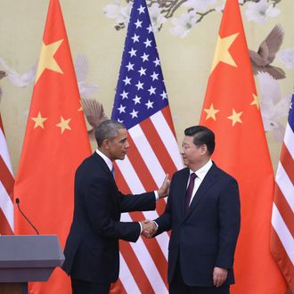 BEIJING, CHINA - NOVEMBER 12: U.S. President Barack Obama (L) shakes hands with Chinese President Xi Jinping (R) after a joint press conference at the Great Hall of People on November 12, 2014 in Beijing, China. U.S. President Barack Obama pays a state visit to China after attending the 22nd Asia-Pacific Economic Cooperation (APEC) Economic Leaders' Meeting. (Photo by Feng Li/Getty Images)