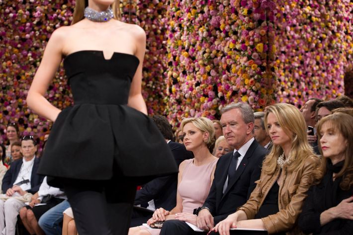Princess Charlene, Bernard Arnault, Delphine Arnault and Isabelle Huppert look at a model during the Christian Dior Haute-Couture show as part of Paris Fashion Week Fall / Winter 2013 on July 2, 2012 in Paris, France.