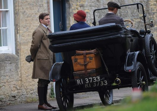 25 Apr 2014, Bampton, Oxfordshire, England, UK --- Filming resumed again today in the Oxfordshire village of Bampton, for the award winning costume drama Downton Abbey. Tom Branson's new love interest Sarah Bunting seems as though she is leaving Downton for a while, as she waits for a car to pick her up with packed suitcases. Pictured: Allen Leech (Tom Branson) and Daisy Lewis (Sarah Bunting) --- Image by ? Wakeham/Splash News/Corbis