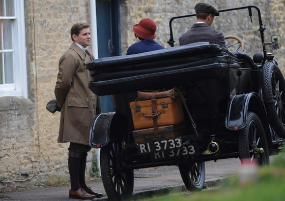 25 Apr 2014, Bampton, Oxfordshire, England, UK --- Filming resumed again today in the Oxfordshire village of Bampton, for the award winning costume drama Downton Abbey. Tom Branson's new love interest Sarah Bunting seems as though she is leaving Downton for a while, as she waits for a car to pick her up with packed suitcases. Pictured: Allen Leech (Tom Branson) and Daisy Lewis (Sarah Bunting) --- Image by © Wakeham/Splash News/Corbis