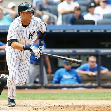 Derek Jeter #2 of the New York Yankees runs out his hit in the fifth inning against the Kansas City Royals on July11,2013 at Yankee Stadium in the Bronx borough of New York City.