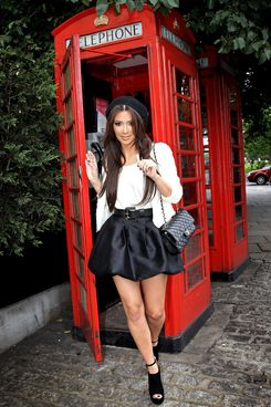 Kim Kardishan leaves a London telephone box as she visits London with her mother Kris Jenner on September 12, 2010 in London, England.