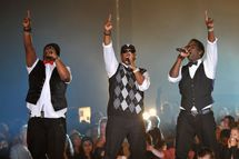 GLASGOW, SCOTLAND - OCTOBER 05:  (EXCLUSIVE COVERAGE)  (L-R) Wayne Morris,  Nathan Morris and  Shawn Stockman  of Boys II Men perform on stage during the MOBO Awards 2011 at the SECC on October 5, 2011 in Glasgow, Scotland.  (Photo by Gareth Cattermole/Getty Images)